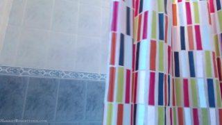Busty asian teen uses showerhead